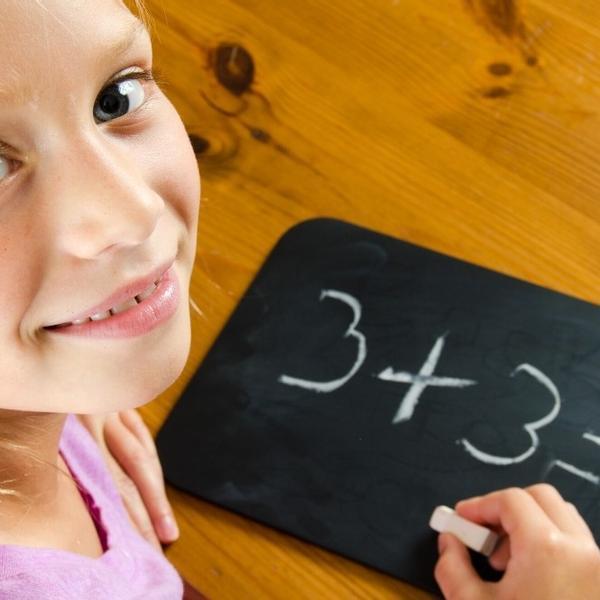 A little girls learning math.