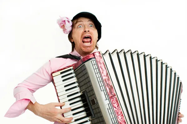 Crazy musician plays the accordion.