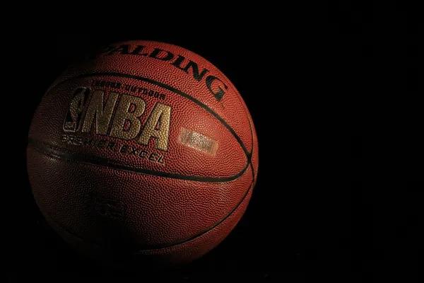 NBA basketball ball on a black background.