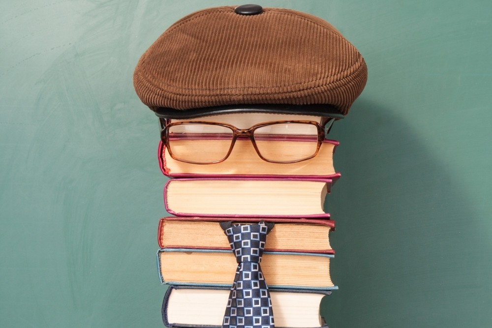 A funny illustration of the general knowledge of many books in the shape of a person.