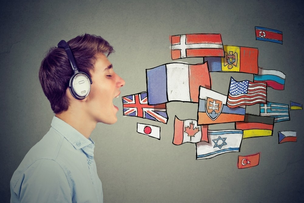 A boy sing in many languages with flags of many countries.