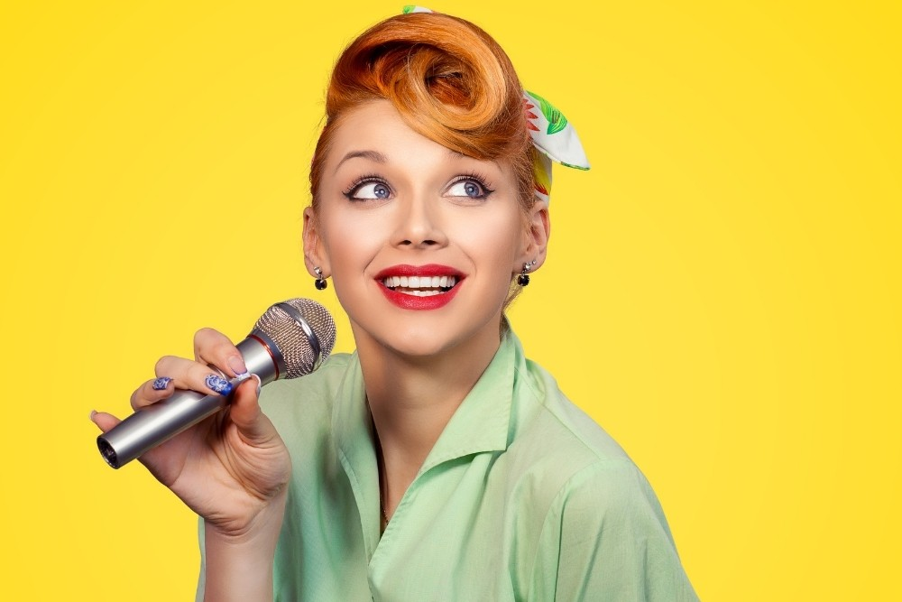A retro singer singing to music sounds.