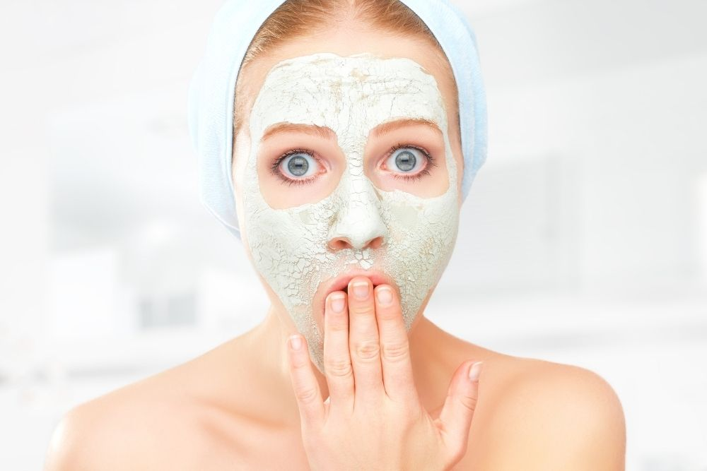 A woman with a facial musk is making a funny face.