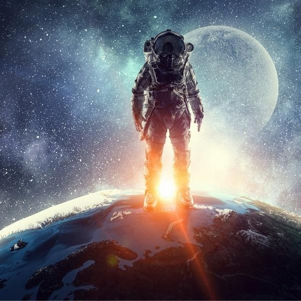 An astronaut standing on Earth and looking at the space and the moon.