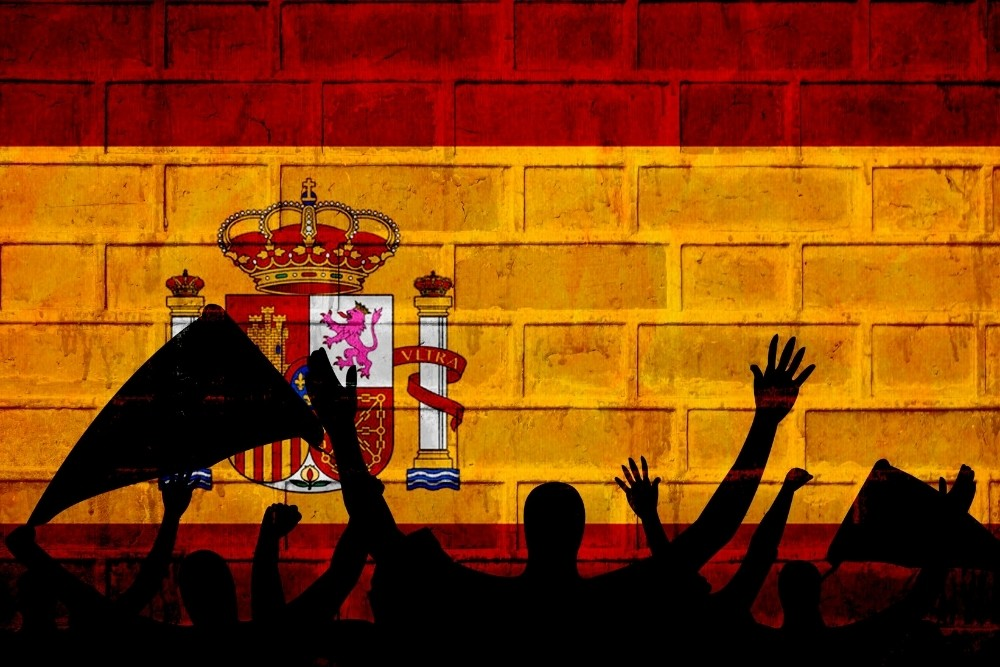People are cheering for the Spanish flag.