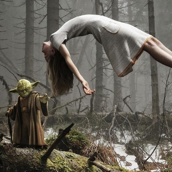 Yoda from star wars lifting a woman in the air.