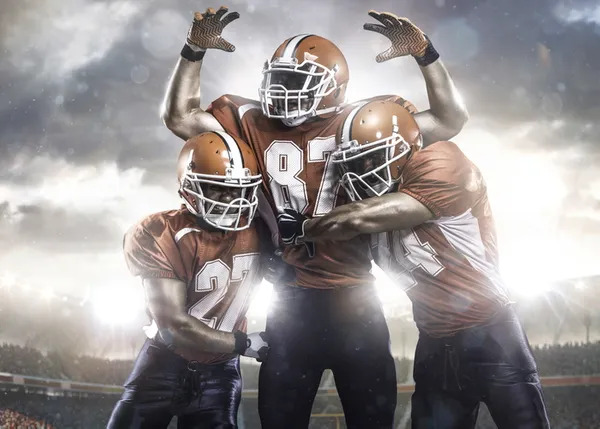 3 American football (NFL) players in action.