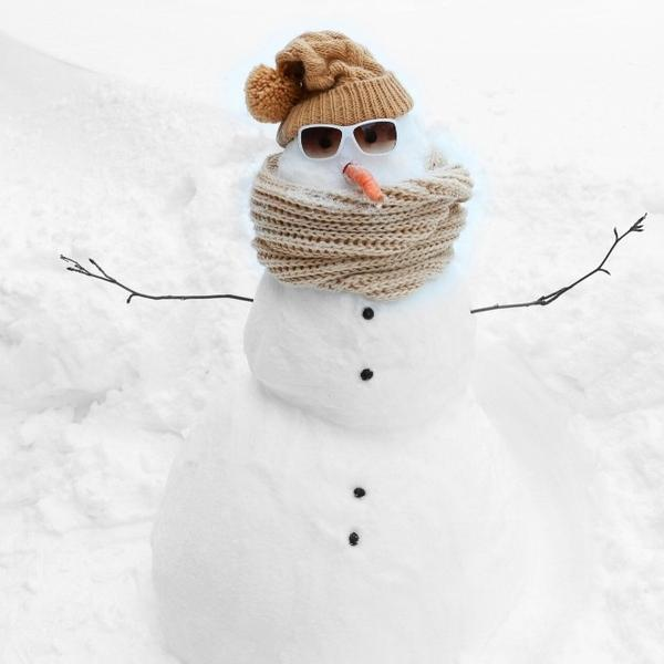 A funny snow man in the winter.