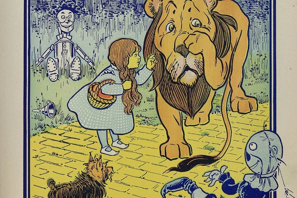 A Wizard Of Oz old post - Dorothy's on the yellow bricks with Toto and more characters.
