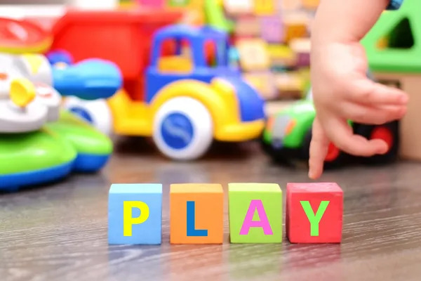 Play games with colorful toys and letters cubes.