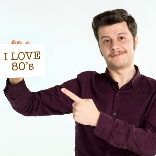 "A man dressed in the 80s style, saying ""I love the 80s""."