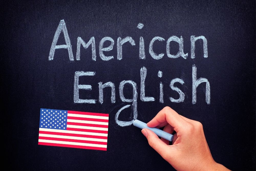 American Dialect or American English is written on a chukleboard.