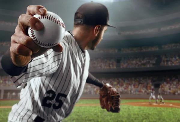 Baseball pitcher throwing the ball.