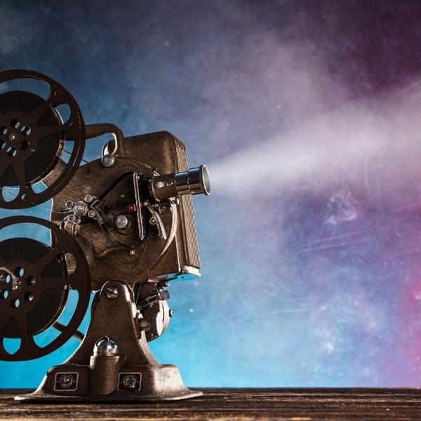 An old film player in a movie theater.