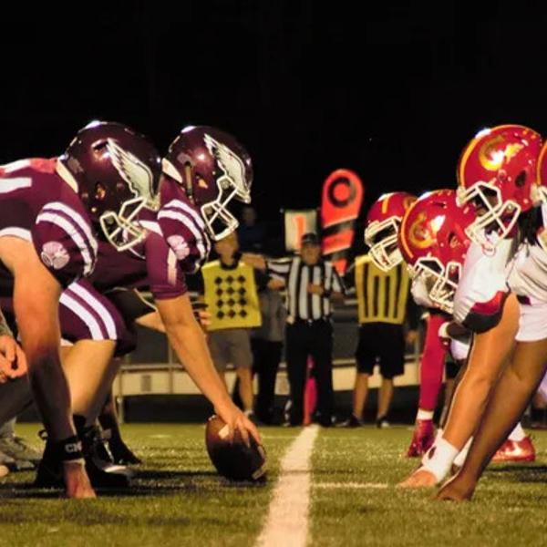 Two Football teams standing in a starting position