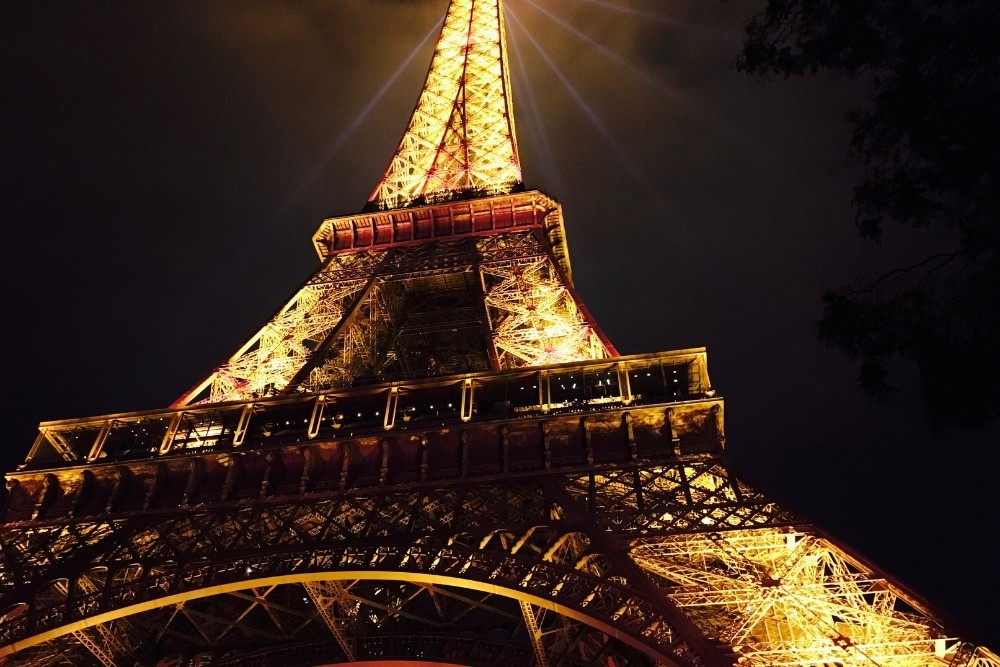 The Eiffel tower in Paris, France, at night.