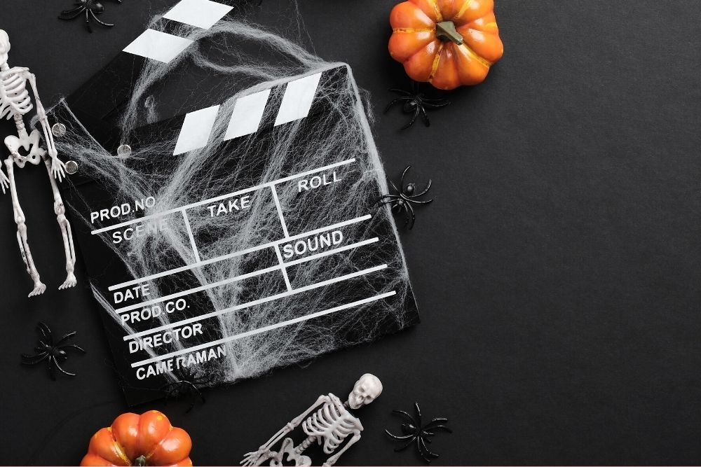 A movie film clapperboard styled for Halloween.