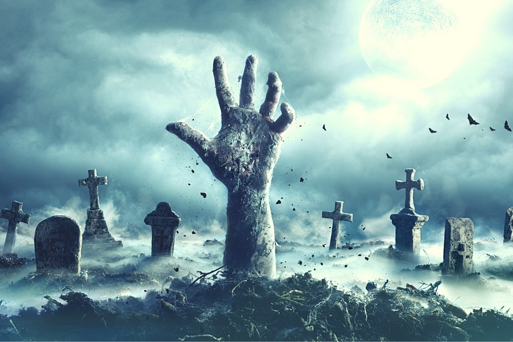 A hand coming out of the ground on Halloween.