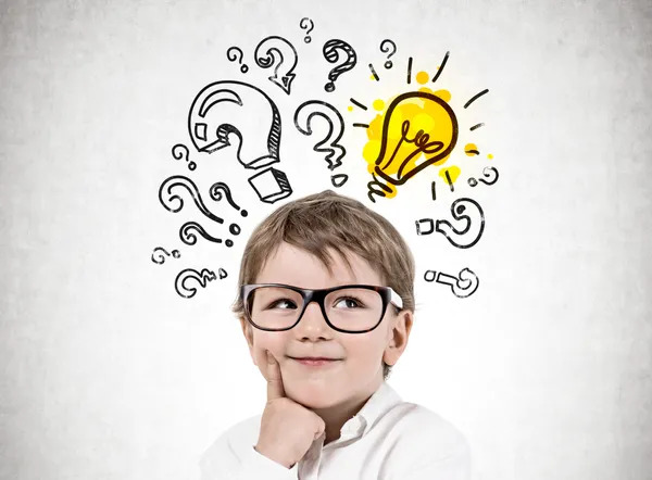 Adorable little boy wearing glasses and thinking, with many question marks and light bulb.