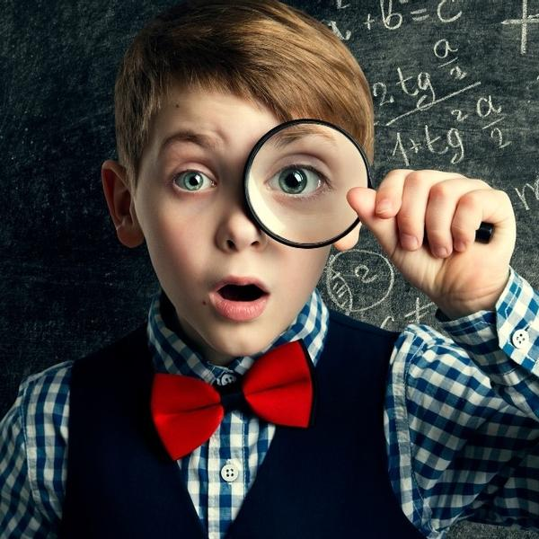 A cute 6th-grade kid with a magnifying glass and a math chalkboard.