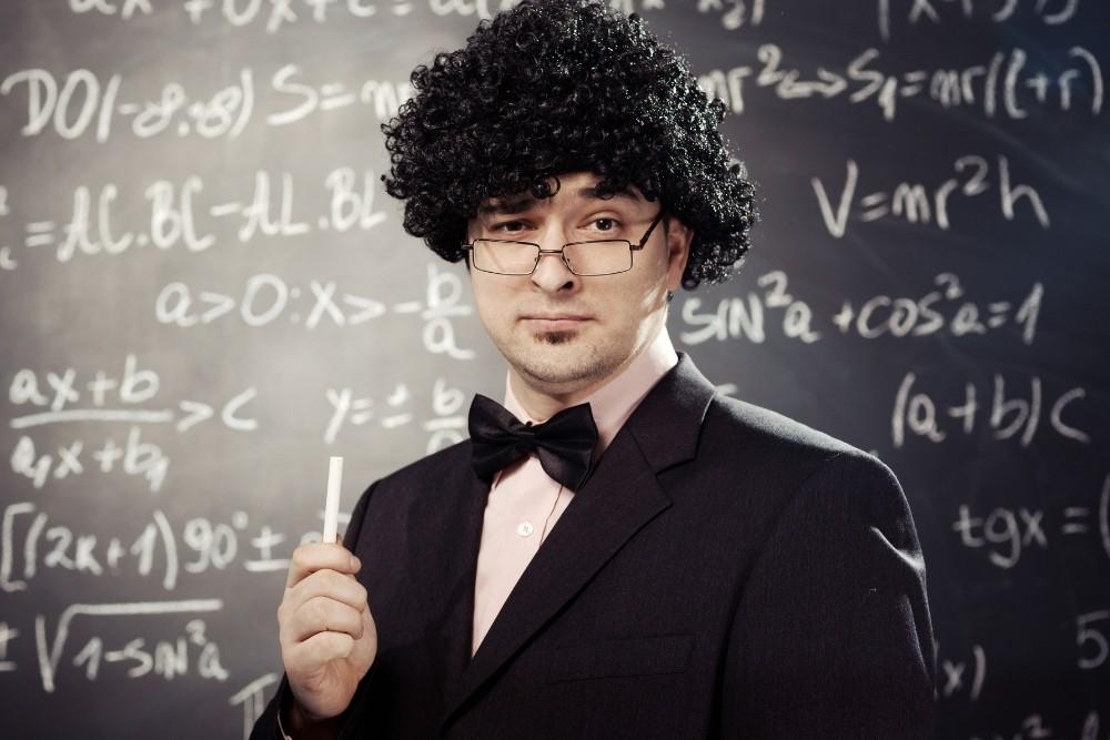 A funny math teacher with a black math chalkboard.