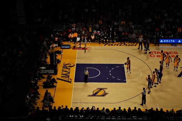 Two NBA Teams playing on the Lakers court.