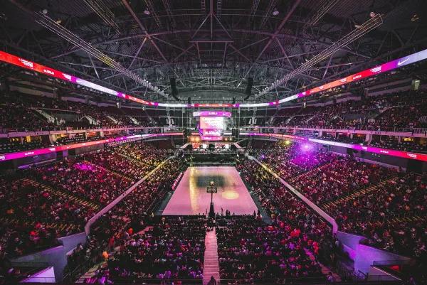 Basketball stadium full of fans during an NBA game.