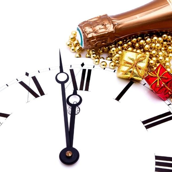 A beautiful clock counting down to the new year with glasses of champagne.