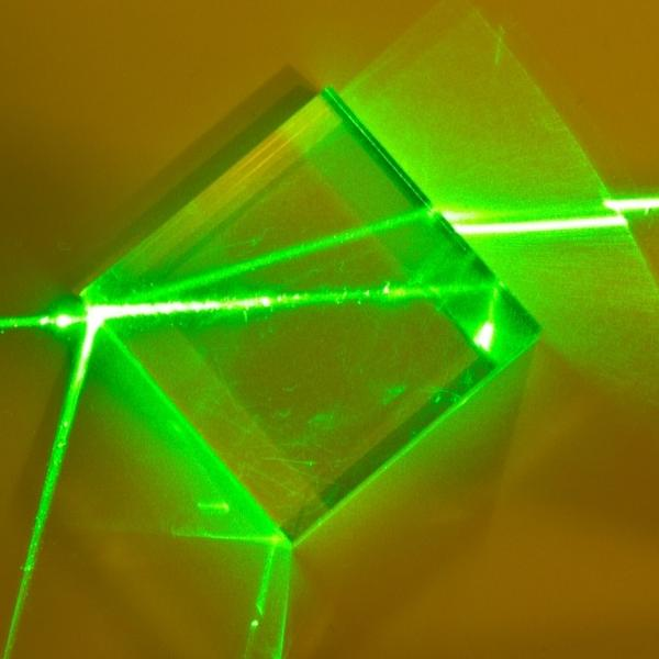 A physics experiment of light moving through glass.