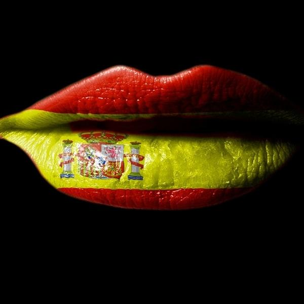 A woman lips painted with the Spanish flag.