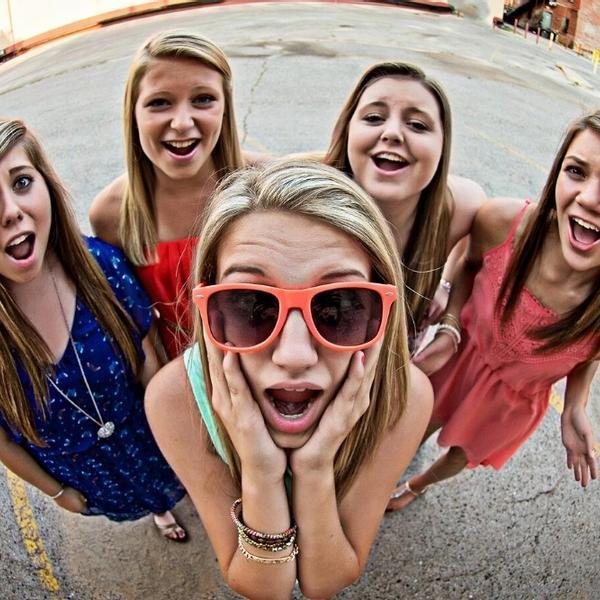 Funny teenage girls looking at the camera.