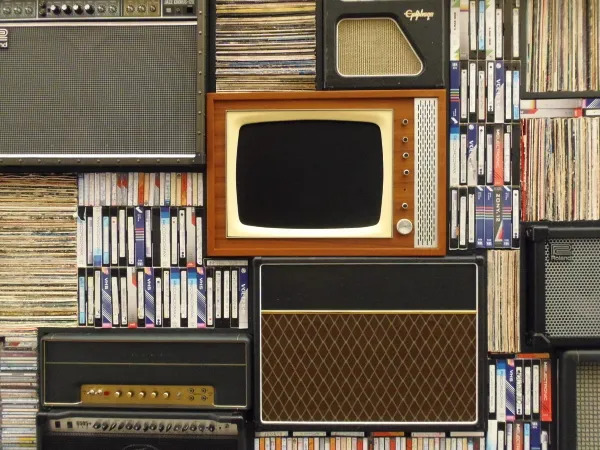 Old tv surrounded by books.