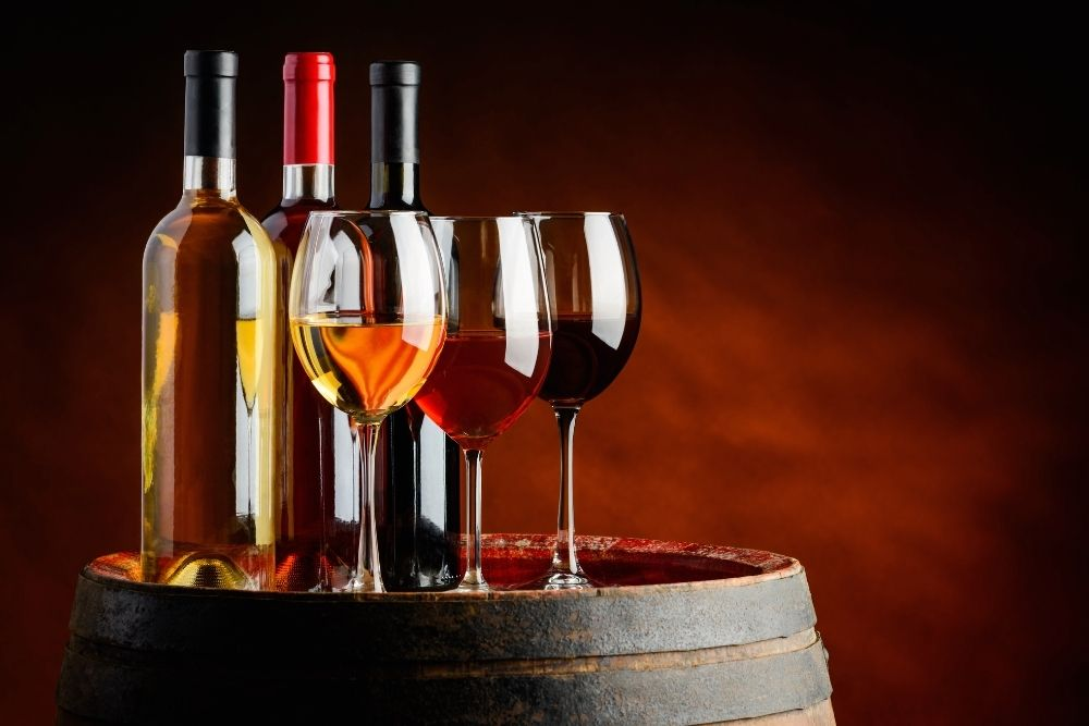 3 types of wines with three glasses of wine.