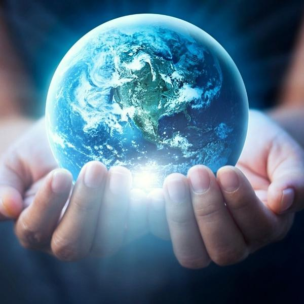 Small model of Earth in the hands of a boy.