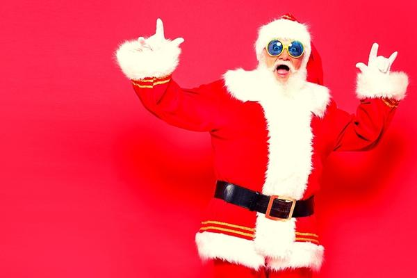 A funny Santa with his two hands in the air.