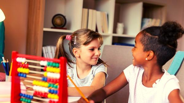 Two little girls solve a 3rd grader math question.